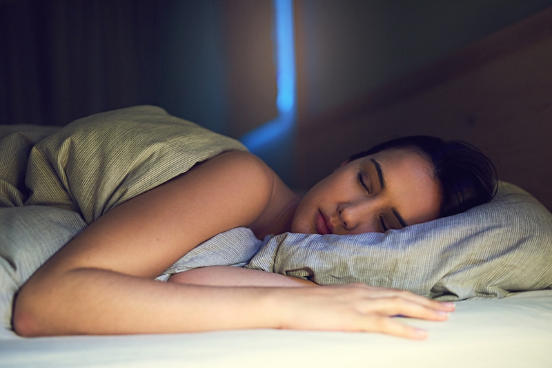 Shot of a young woman sound asleep in her bedroom