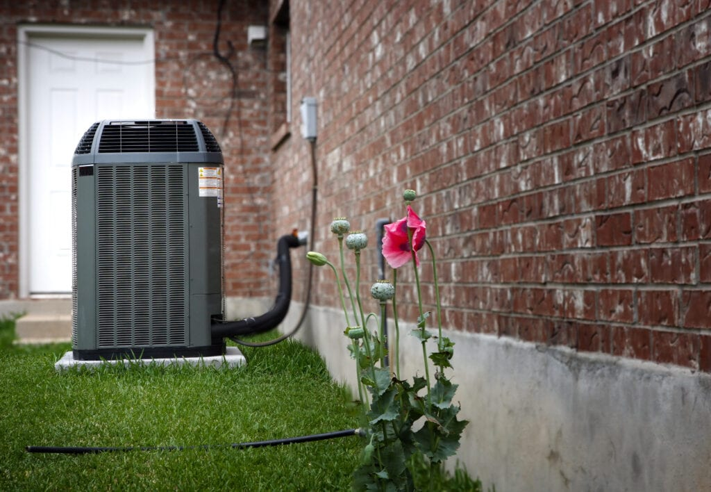 """""""High efficiency modern central air conditioner, energy save solution on backyard"""""""