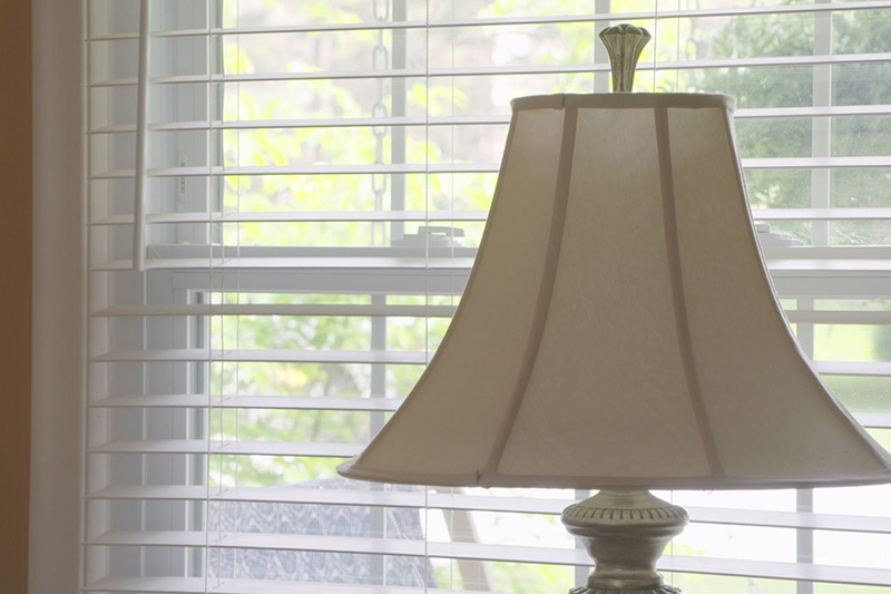 a lamp by a window