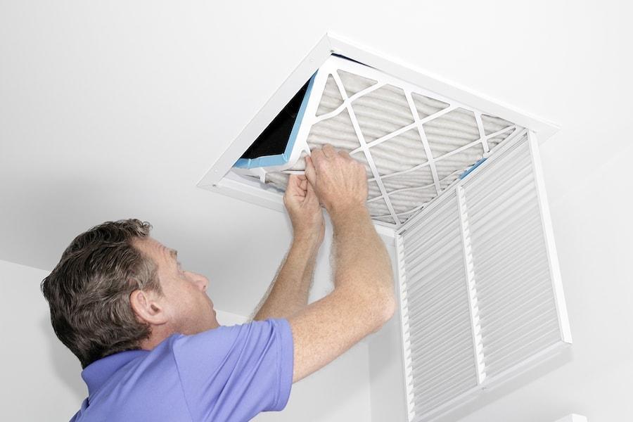 Man Removing Dirty Air Filter